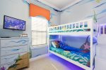 The kids will love this themed room with full and twin bunk beds
